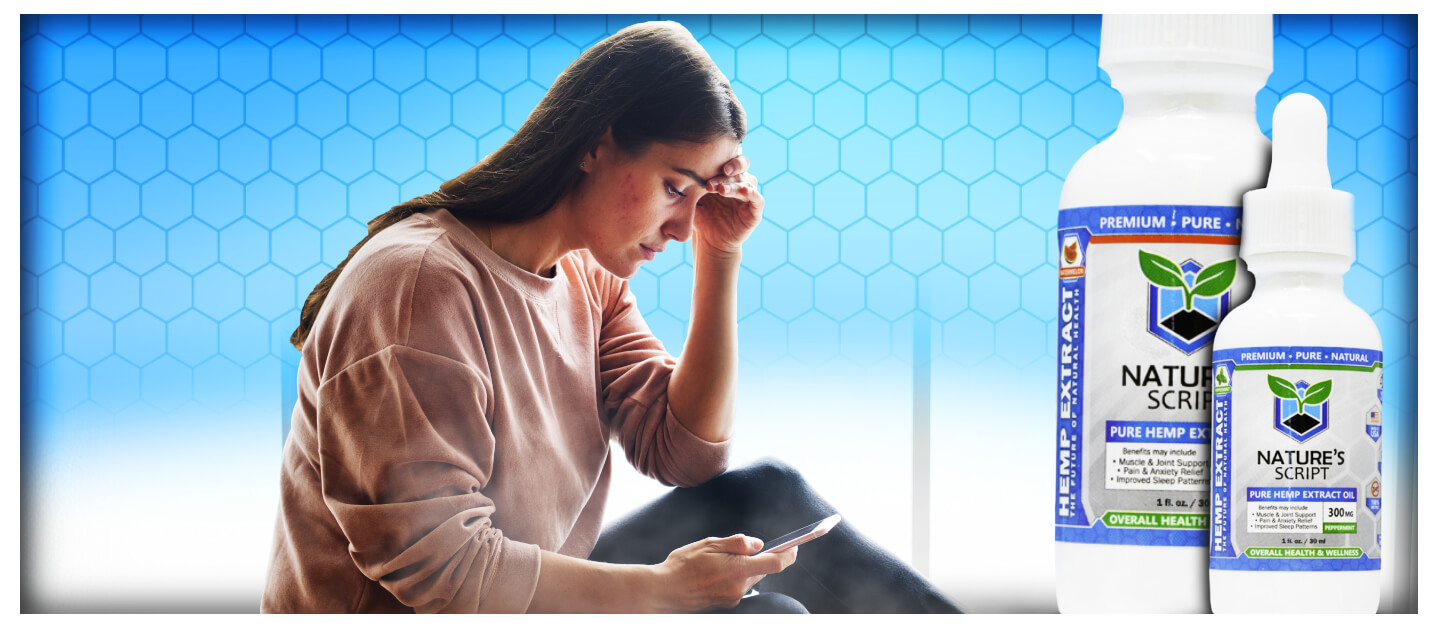 Stressed woman looking at phone CBD oil for anxiety preview